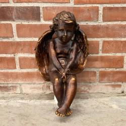 Ángel color bronce sentado