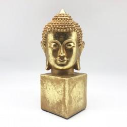 Cabeza Buda gold sobre pedestal