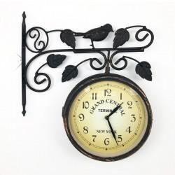 Reloj metálico diseño pajarito doble cara